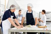 Chefs Talking While Preparing Pasta At Commercial Kitchen — Stock Photo