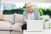Happy Senior Man Video Chatting On Laptop At Porch — Stock Photo