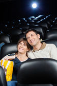 Happy Loving Couple Watching Film In Theater — Stock Photo