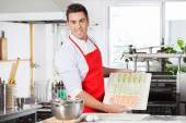 Confident Chef Presenting Raw Ravioli Pasta On Cutting Board — Stock Photo