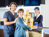 Expectant Couple Buying Snacks From Seller At Cinema Concession — Stock Photo