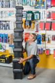 Man Shouting While Carrying Stacked Toolboxes In Store — Stock Photo