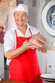 Butcher Showing Meat In Butchery — Stock Photo