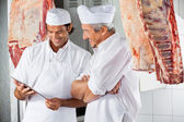 Butchers Looking At Digital Tablet In Butchery — Stock Photo