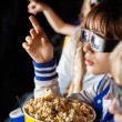 Girl Pointing While Watching 3D Movie With Siblings — Stock Photo #59071747