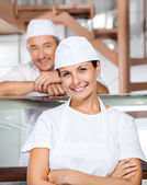 Happy Female Butcher With Colleague At Butchery — Stock Photo