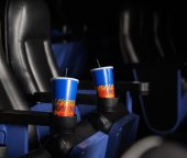 Cold Drinks In Armrests Of Seats At Theater — Stockfoto