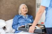 Midsection Of Nurse Serving Breakfast To Senior Woman — Stock Photo