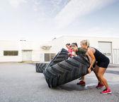 Athletes Flipping Tires — Stock Photo