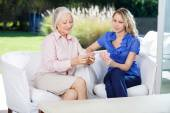 Card game with Senior and Mid adult woman. — Stock Photo