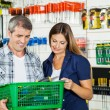 Couple Carrying Basket Full Of Tools In Store — Stock Photo #61578565