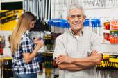 Confident Senior Man With Arms Crossed In Hardware Shop — Stock Photo