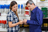 Vendor Showing Wrench To Customer In Shop — Stock Photo