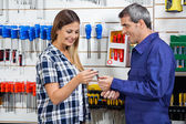 Vendor Giving Wrench To Customer In Shop — Stock Photo