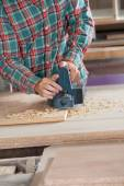 Worker Using Electric Planer On Wood — Stock Photo