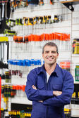 Worker Standing Arms Crossed In Hardware Shop — Stock Photo