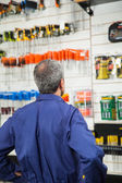 Worker Looking At Tools In Hardware Store — Stock Photo