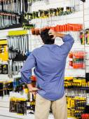 Confused Customer Scratching Head In Hardware Shop — Stock Photo