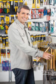 Man Buying Hammer In Hardware Store — Stock Photo