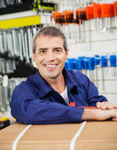 Happy Mature Worker Leaning On Tool Package — Stock Photo