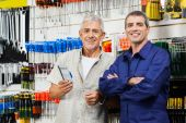 Vendor With Customer Standing In Hardware Shop — Stock Photo