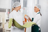 Happy Chefs Conversing While Holding Pasta Sheets — Stock Photo