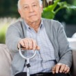 Portrait Of Elderly Man Holding Metal Cane — Foto Stock #61632279