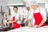 Happy Chefs Conversing In Commercial Kitchen — Stock Photo