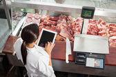 Butcher Using Digital Tablet In Butchery — Stock Photo