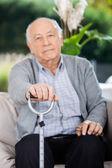 Portrait Of Elderly Man Holding Metal Cane — Stock Photo