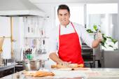 Confident Chef Gesturing Thumbsup While Rolling Ravioli Pasta Sh — Stock Photo