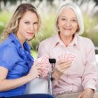 Portrait Of Granddaughter And Grandmother Playing Cards — Stock Photo #61682551