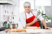 Confident Chef Holding Tongs While Preparing Ravioli Pasta In Ki — Stock Photo
