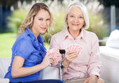 Portrait Of Granddaughter And Grandmother Playing Cards — Stock Photo