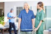 Nurse Assisting Senior Woman To Walk With Zimmer Frame — Stock Photo