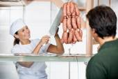 Butcher Selling Sausages To Male Customer — Stock Photo