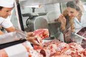 Woman Buying Meat At Butchery — Stock Photo