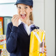 Worker Eating Popcorn At Cinema Concession Stand — Stock Photo #62226727