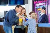 Playful Family Enjoying Snacks At Cinema Concession Stand — Photo