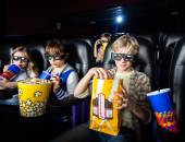 Siblings Having Snacks In 3D Cinema Theater — Stock Photo