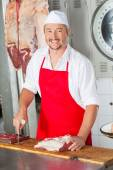 Male Butcher With Red Meat At Butchery — Stock Photo
