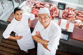 Confident Butchers Standing At Butchery Counter — Stock Photo