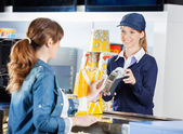 Worker Accepting Payment From Woman Through NFC Technology At Ci — Stock Photo