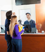 Couple Checking Movie Schedule At Box Office — Stock Photo