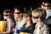 Happy Families Watching 3D Movie In Theater — Stock Photo