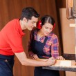 Carpenters Measuring Wood In Workshop — Stock Photo #62421473