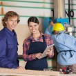 Carpenters With Digital Tablet In Workshop — Stock Photo #62421721