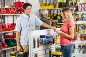 Couple Choosing Tools In Hardware Store — Stock Photo