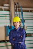 Confident Carpenter Against Vertical Saw Machine — Stock Photo