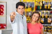 Couple Pointing At You In Hardware Store — Stock Photo